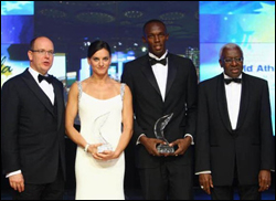 Prince Albert II of Monaco, Russian pole vaulter and female World Athlete of the Year Yelena Isinbayeva, Jamaican triple-Olympic medalist Usain Bolt and IAAF President Lamine Diack at the IAAF World Athletics Gala where the Caribbean sprint star took the title of male World Athlete of the Year.