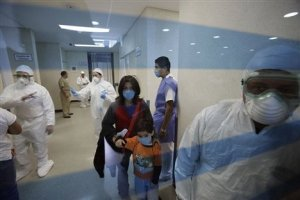 Patients leave the emergency room of the Naval hospital as doctors wear protective gear in Mexico City, Tuesday 28th April 2009 (AP)